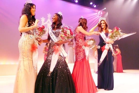 The winners of the 2013 Miss Teen Westchester and Hudson Valley and Miss Westchester and Hudson Valley Pageants congratulate each other on stage at the White Plains Performing Arts Center.