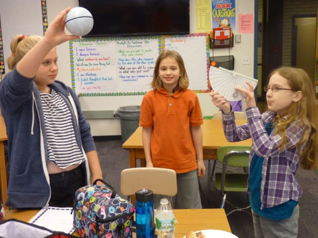 Sixth-grade students in John Jay Middle School take part in World MOON project.