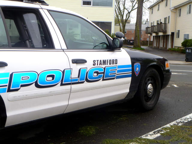 Stamford Police ticketed a local driver after he struck a school crossing guard.