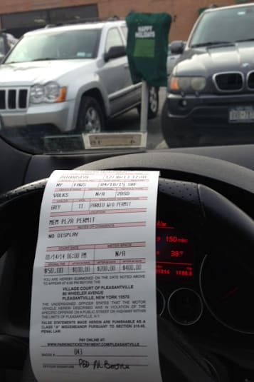 A ticket for a car in Pleasantville.
