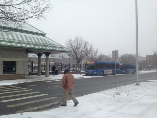 It's cold and a light snow is falling at the bus stop in downtown Danbury on Tuesday afternoon.