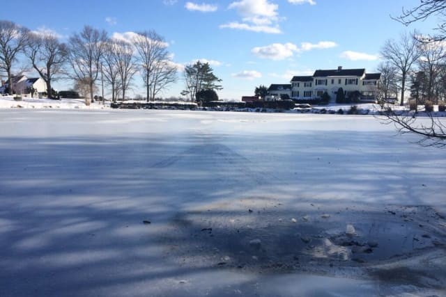 Two teenage boys are safe after being pulled from this icy pond in Greenwich.