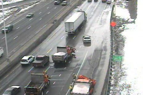 Crews work to fix a water main break on I-95 south in Norwalk.