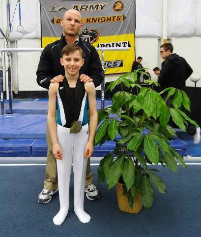 Gymnast Bryce Polenz with coach Bob Kayser.