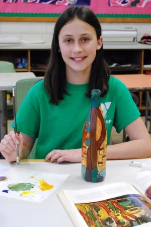 "Darien Arts Center student Jenna Funkey puts the finishing touches on her artwork, which will be featured in the ""Drawn to Nature"" Art Show at the Darien Nature Center during February."