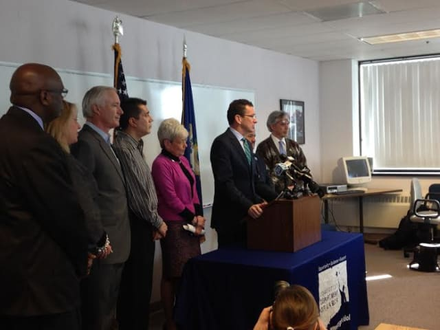 Gov. Dannel Malloy proposes an increase in the minimum wage to $10.10 per hour by 2017 during an event Tuesday in Bridgeport.