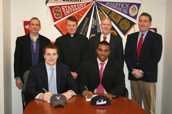 Fairfield Prep football players Nick Crowle, (front, left) and Tony Fox sign to play for college programs. Back row are Dr. Robert Perrotta, Principal; Rev. John Hanwell, S.J., President; Tom Shea, coach ; Keith Hellstern, assistant coach.