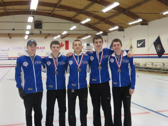 Tean Dunnam, with Briarcliff resident Andrew Stopera (second from right), celebrates their second place finish at curling nationals in Seattle.