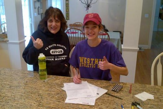 Westhill senior Claire Howlett signs her letter of intent to Stanford University as her mother, Lisa, gives her approval.