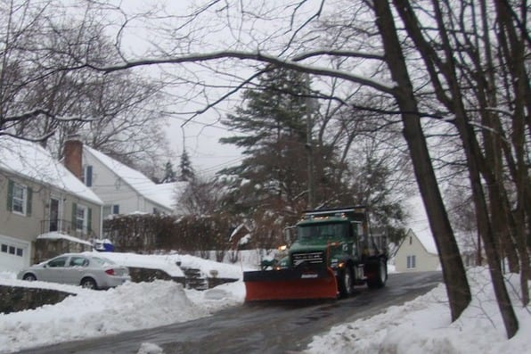 Plows arrive on Fairfield Terrace in Norwalk to clear the streets Wednesday. It is important to clear the snow and slush before it refreezes and forms black ice.