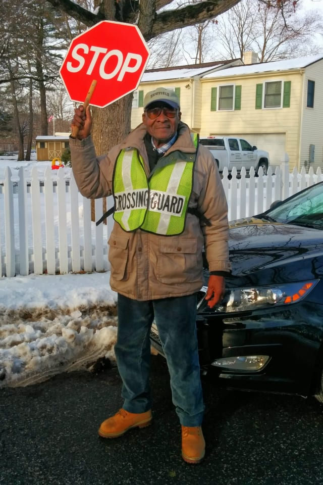 Stamford's Roosevelt Mitchell puts a smile on kids' faces in his job as a crossing guard at Pepperidge and Harvest Hill Roads.