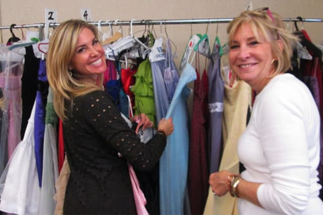 Volunteers help sort donated clothing for Operation PROM, which recently expanded to Connecticut via a Darien business.