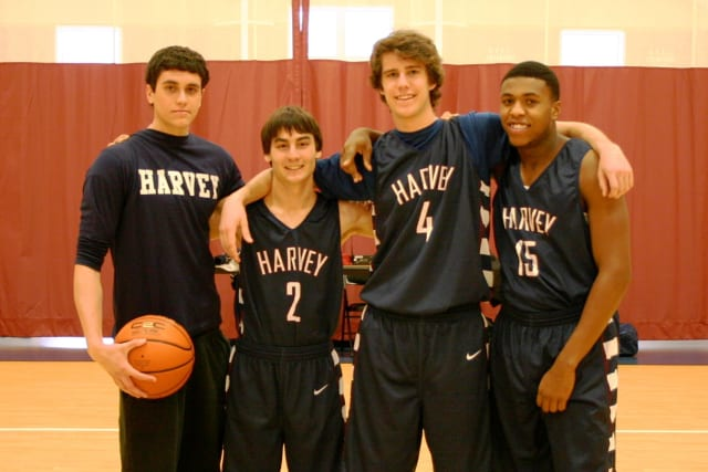 Seniors Andrew Schwartz, Christian Artuso, Jake Cohn and Deshawn Hilliard were honored before the Harvey School's recent game.