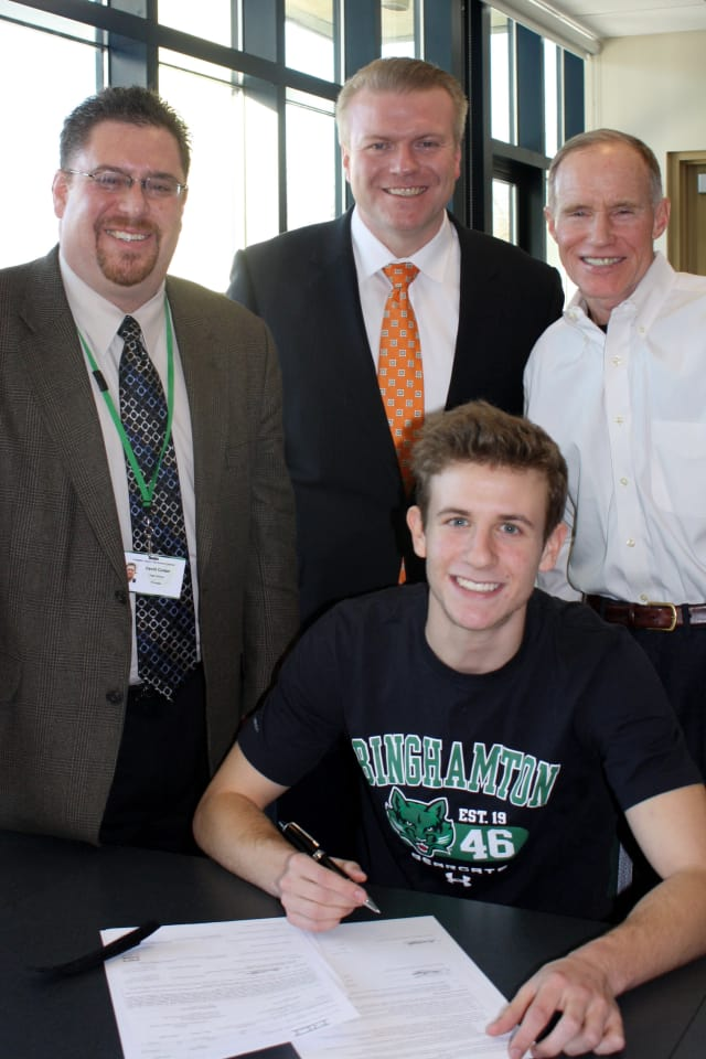 Irvington High School senior Ben Ovetsky, front, signs his National Letter of Intent to play Division I soccer for Binghamton University. Principal David Cohen, Superintendent Dr. Kristopher Harrison & former principal Scott Mosenthal look on.
