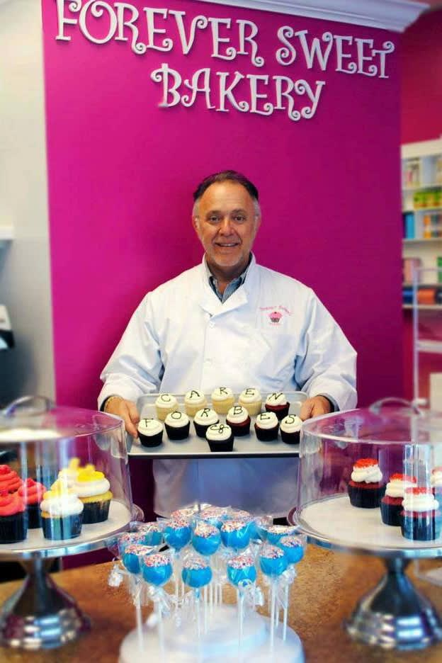 Sky Mercede, co-owner of Forever Sweet Bakery in Norwalk, shows off some of his bakery's signature cupcakes.