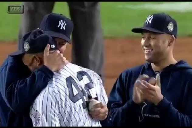 New York Yankee Derek Jeter watches as teammate Mariano Rivera retires last year.
