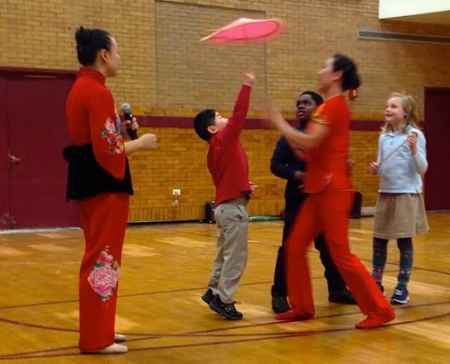 Chapel School students take part in the interactive part of the Chinese New Year assembly.