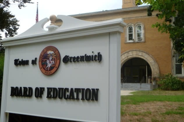 The Greenwich School system honored four parents who assisted in saving a woman's life during a workshop recently.