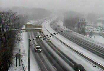 Traffic is light and snow is beginning to coat I-5 northbound at Exit 3 for Arch Street in Greenwich on Tuesday morning.