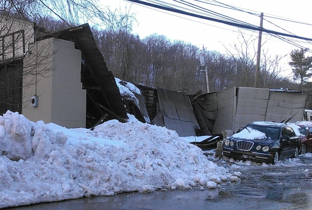 A roof and walls of a garage in New York collapsed during a recent snowstorm.
