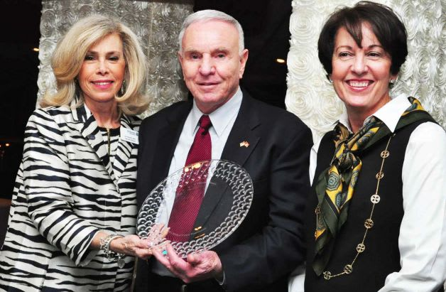 Foundation Executive Director Lyn McCarthy presents Fairfield Fire Chief Richard Felner and his, wife, Linda, with the St. Vincent Medical Center Foundation Center's David Felner Caregiver Award.