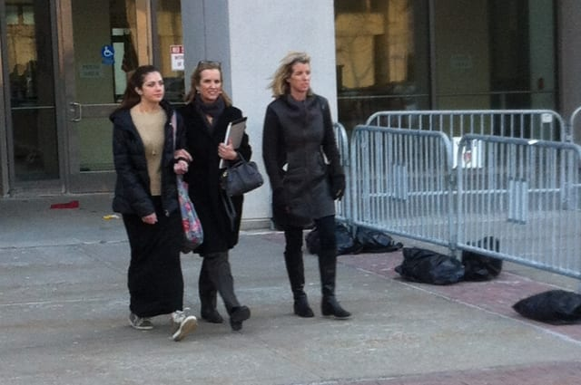 Bedford resident Kerry Kennedy (center) exits the Westchester County Courthouse in White Plains Tuesday following the second day of her trial.