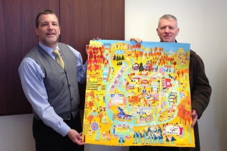Wartburg President & CEO David J. Gentner, left, and artist Christopher Corr unveil the Wartburg Fall Festival painting.