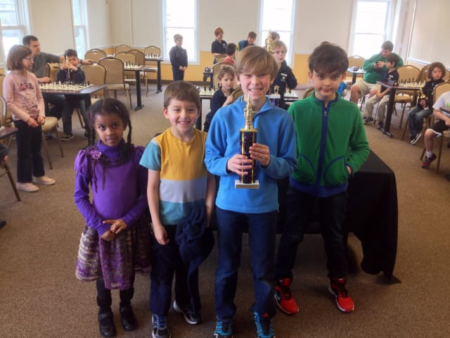 From left: Tiffany Jennings, Cyrus Pearson, Justin Higgins and Jackson Benett placed second in a recent chess tournament.