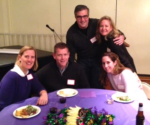 Megan and David Hammer, Andy and Meredith Petitjean, and Jan Sulkowski enjoy the Mardi Gras-themed Winter Blues party at the New Canaan Presbyterian Church.