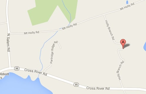 Cross River Road was closed for 40 minutes Wednesday due to an overturned car.