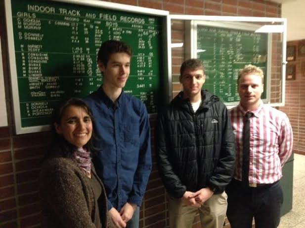 Hastings assistant track and field coach Andrea Kane, Peter Clark-Deutsch, Ben Torda and coach Neal Rosengren.