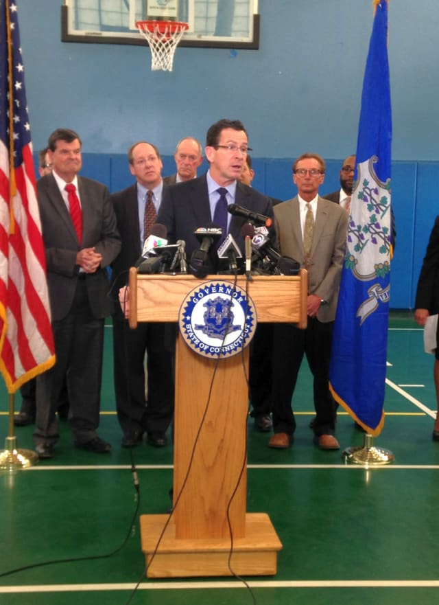 Gov. Dannel Malloy announces his bill Wednesday at the Trinity College Boys & Girls Club, which boasts a tobacco resistance and awareness program for club members ages 13 to 15 funded by the Tobacco and Health Trust Fund.