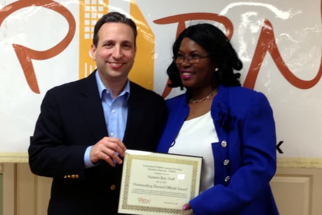 "Daisy Franklin of Norwalk presents State Sen. Bob Duff (D-Norwalk) with the state-wide Public Housing Resident Network's ""Outstanding Elected Official"" award."