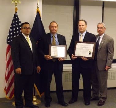 New Rochelle Police Lt. Cosmo Costa (second from left) and Capt. Robert Gazzola (second from right) accept an award in Albany.