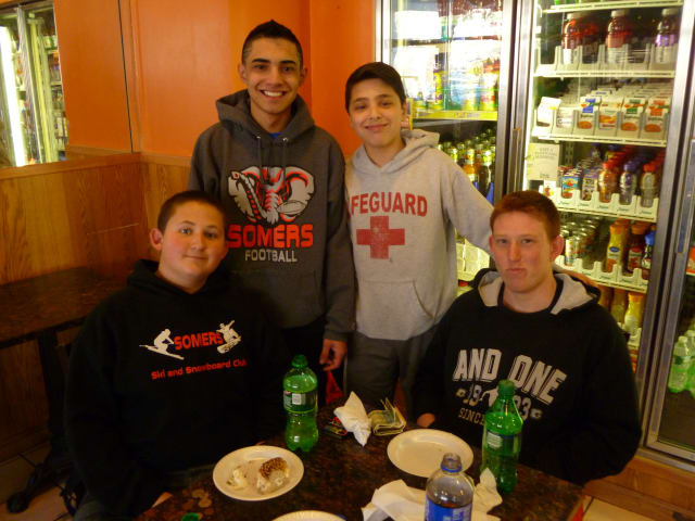Gio Tideto (back right) talks college basketball with his friends from Somers Middle School Tuesday.