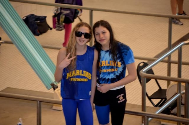 Members of the Marlins swim team pose after their swim meet.