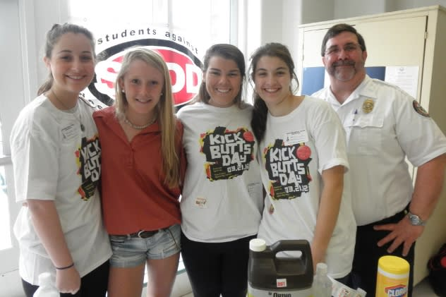 "Pictured are SADD members Colleen Heaney, Haley Close, Sloane Clarke, Caroline Feehan, and Fire Marshal Bob Buch at ""Kick Butts Day"" at Middlesex Middle School, one of the many national events in which the Darien chapter of SADD participates."