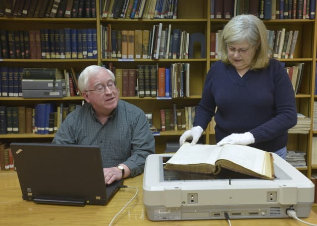 WCSU Adjunct Librarian Roseanne Shea and her husband, Gerald, help scan more than 2,600 pages of 19th century documents available at WCSU in Danbury.