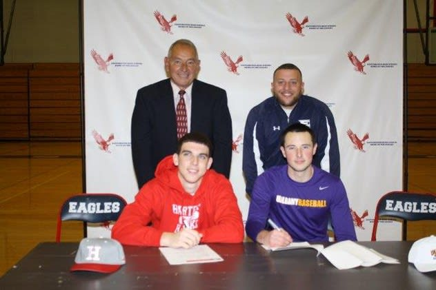 Infielders Mike Milo and Nick Campana sign their letters of intent with Coach Dom Cecere and Athletic Director Jason Karol.