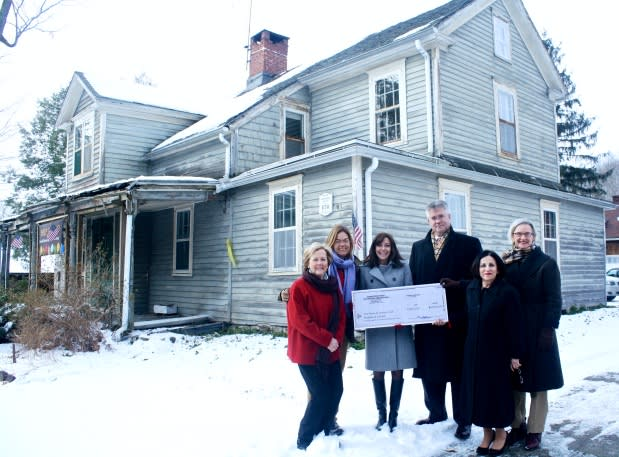 Rep. John Shaban and Sen. Toni Boucher with Weston First Selectman Gayle Weinstein and Friends of LaChat member Carol Baldwin to accept a check from Helen Higgins, executive director of the Connecticut Trust for Historic Preservation.