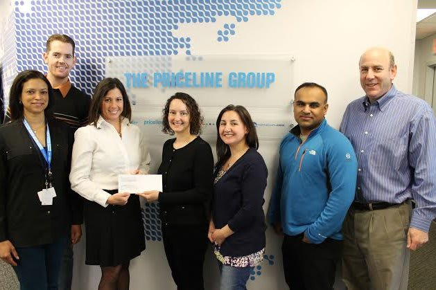 Family Centers' Director of Community Engagement Jennifer Flatow (second from left) accepts a check from Priceline.com employees (l-r) Angela Jamerson, Ben Harrell, Jill Saverine, Eleana McNeill, Baiju Thakkar and Ken Weil.