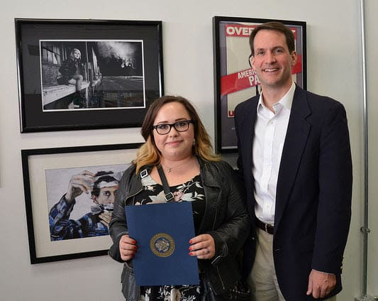 """U.S. Rep. Jim Himes with Shannon Magnaldi of Fairfield, who won last year's Congressional Art Competition for her piece, """"Off Peak."""""""