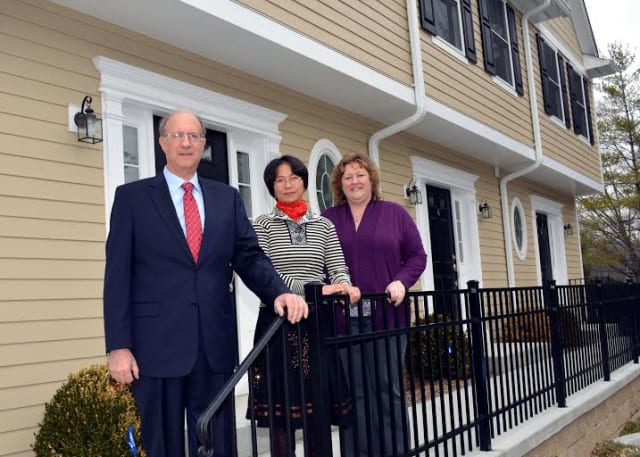 Pictured at the Comstock Heights Condominium, are, from left, Gerald Calvario, vice president of Residential Lending, CMS Bank; Comstock Heights Condominium, homeowner Elly Chiu and Terry Fleischman, homeownership director, Housing Action Council.
