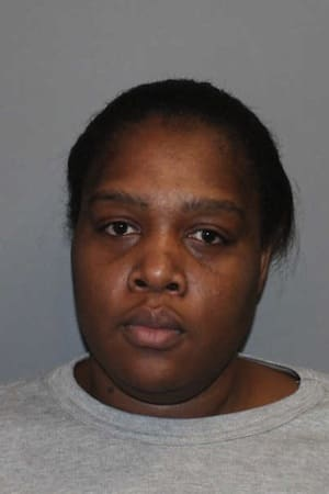Maria Dorissaint of Stamford was charged in Norwalk with stealing the identities of her sister and an elderly man she worked for as a health care aide.