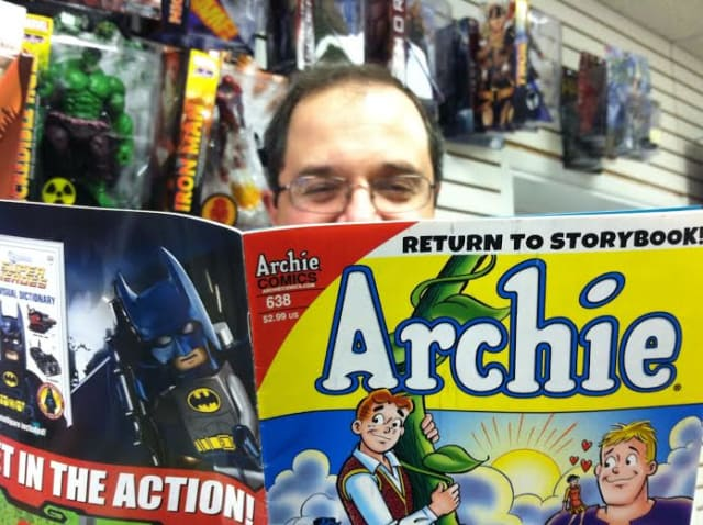 "A Timeless Journey owner Paul Salerno checks out an Archie comic at his Stamford comic book store business. The adult Archie in the series ""Life With Archie,"" will be killed off in July."