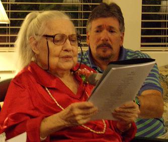 The Country House resident Diana Terry reads her story of a lifetime as Activities Director Paul Raigaud listens.