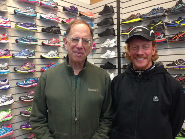 Andrew Kimerling, owner of Westchester Road Runner, and employee Gerry Sullivan.