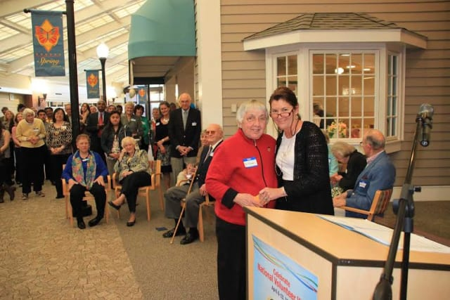 Longtime Waveny LifeCare Network volunteer Fiz Tomaselli is presented with an award for her astounding 3,700 volunteer hours of service during the ceremony in New Canaan.