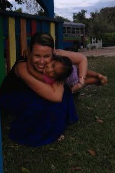 Lindsay Seekircher of Peekskill, a member of Tarrytown-based Fortress Bible Church, volunteers on medical aid missions to impoverished nations. She gets a hug from a young child on her most recent trip in March to Belize.