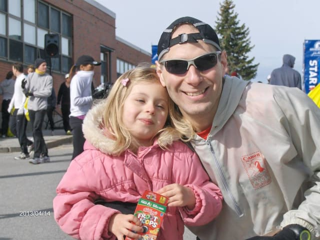 Hartsdale's Brian Wilantowicz and his daugther after the 2013 Boston Marathon. He completed this year's in 3:08.01.